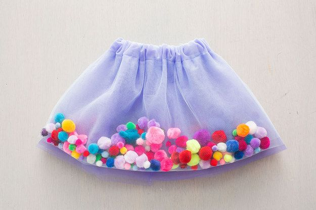 Fill up a tutu with pom poms.