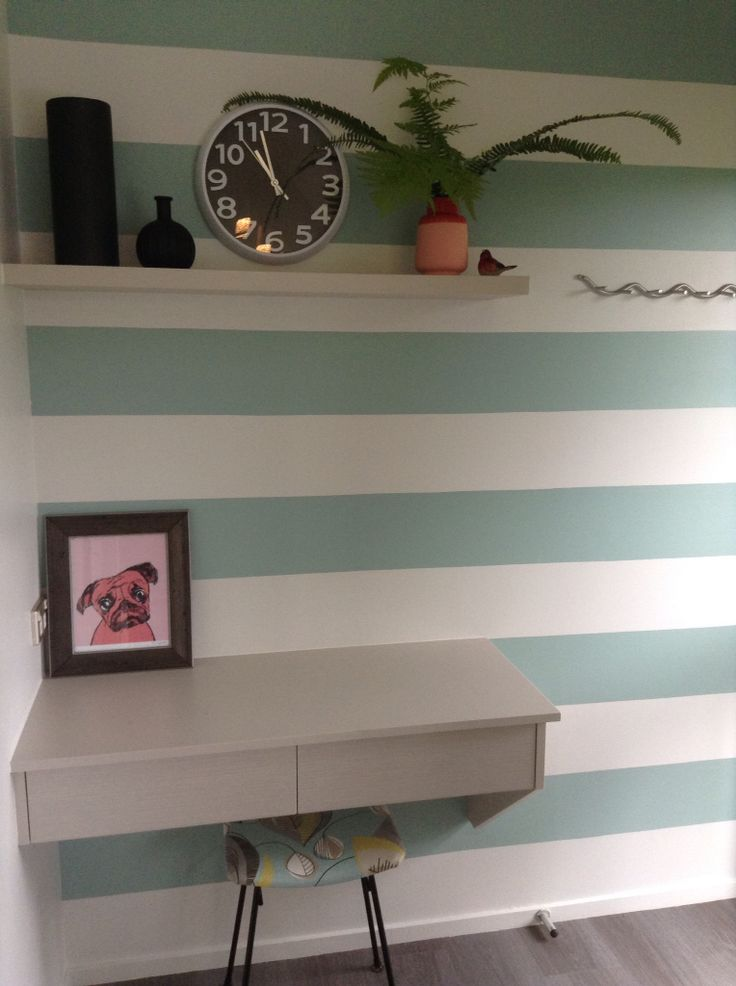 Decorative stripe wall painted on end kitchen wall to give the illusion of the room being wider.