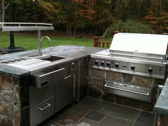 This outdoor kitchen features top of the line Viking appliances and a bluestone countertop (Neave Group, NY)