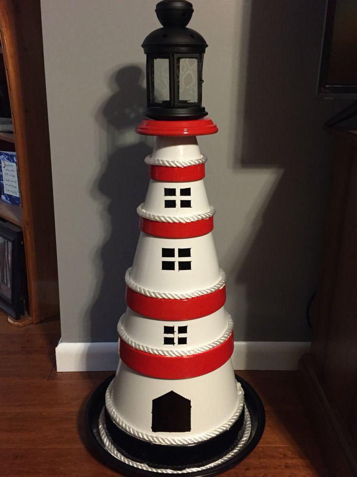 Clay terra cotta pot lighthouse.