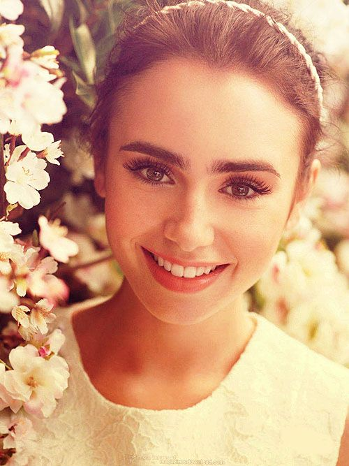 Gorgeous Lily Collins and her famous eyebrows. (We don't mind her dad's music either :)