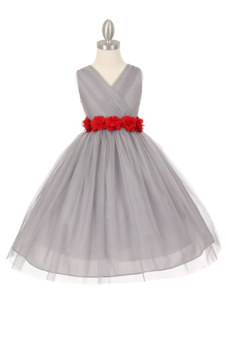 A truly amazing and timeless dress that everyone will love. This sleeveless style dress is perfect for an upcoming wedding or special event. Take note of the intricate pleating throughout the bodice. The dress is youthful enough for younger children but sophisticated enough for junior bridesmaids. The full tulle skirt will surely make your little one feel like royalty and so will everyone else! Zipper closure. The dress is fully lined for complete coverage to ensure that your princess stays…