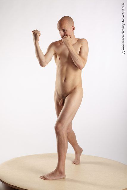 PHOTO OF NUDE MARTIAL ART MAN WHITE STANDING POSES - ALL SLIM BALD STANDING POSES - SIMPLE