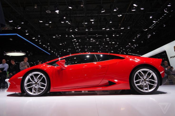 The blood-red Italian sports car in front, the super expensive one that goes really fast, is a Lamborghini. In spite of being Ferrari's signature color, red is also a standard option from...