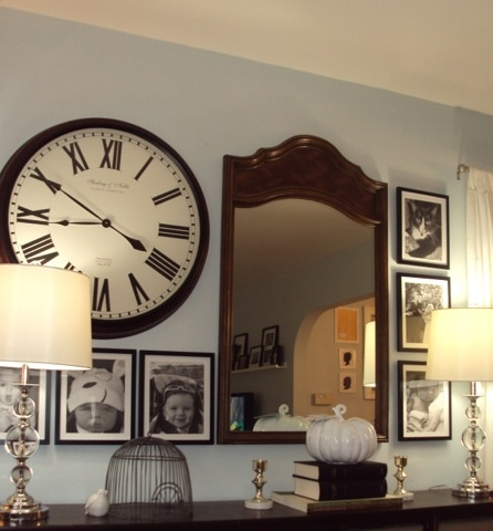 Goodwill mirror turns boring clock wall into an interesting gallery wall