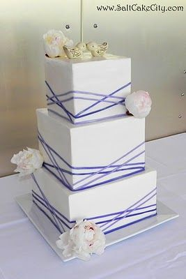 This is the cake! Top layer is Salted Caramel Apple, middle layer is Irish Cream, and the bottom layer is Salted Caramel Apple. The ribbons will be in a darker lime green and navy blue, our wedding colors! :)