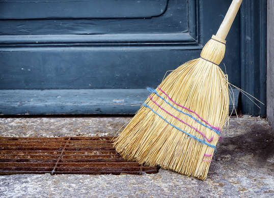 Whether you sweep with an old-fashioned corn broom or a new-fangled microfiber version, brooms benefit from regular cleaning. A good shake outside the house will get rid of most trapped dust and debris. For a deeper clean, swish the broom in a bucket of hot, soapy water and rinse thoroughly with cold running water. Don't let the broom soak; this can weaken the bristles. Hang to dry, or lean with the broom head up before storing.