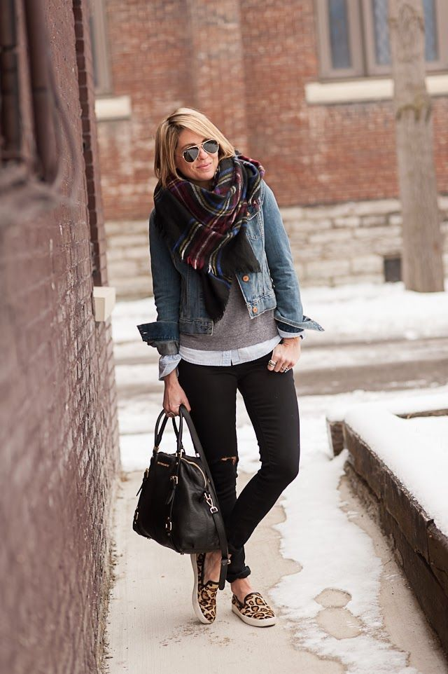 Opt for a blue denim jacket and black ripped skinny jeans for a standout ensemble. Dress down your look with brown leopard slip-on sneakers.  Shop this look for $148:  http://lookastic.com/women/looks/sunglasses-scarf-denim-jacket-v-neck-sweater-dress-shirt-skinny-jeans-tote-bag-slip-on-sneakers/4119  — Black Sunglasses  — Burgundy Plaid Cotton Scarf  — Blue Denim Jacket  — Grey V-neck Sweater  — White Dress Shirt  — Black Ripped Skinny Jeans  — Black Leather Tote Bag  — Brown Leopard ...