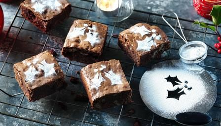 A Christmas treat for chocolate fans! Festive brownies laced with brandy-soaked cranberries, pecans and mixed spice.