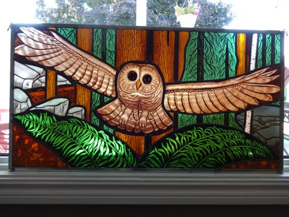 Owl in flight painted stained glass panel
