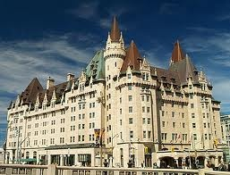 Chateau Laurier in Ottawa, Ont.  Commissioned by Charles Melville Hays and was due to open on April 26, 1912 but was pushed back to June when Hays perished on Titanic (he was on his way to the Grand Opening).  Currently a Fairmont Hotel.