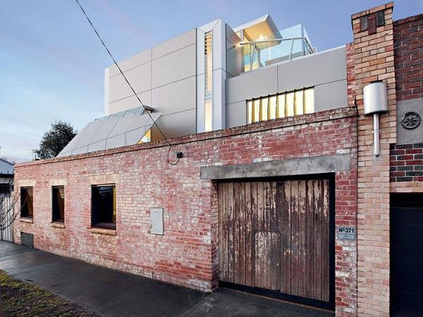 warehouse conversion to modern home... love the contrast of materials