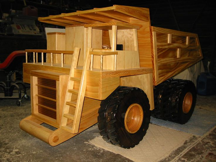 Wooden Toy Trucks For 3 Year Old : A yard full of wooden construction equipment models in