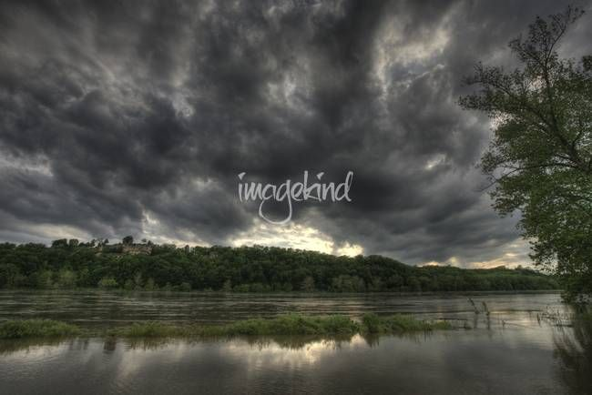 """""""Dark Clouds"""" by Chris Wolters Photography, Missouri // Storm clouds creep in over the Missouri River during the flood of 2007.  This was taken at the Eagle Bluffs Conservation Area near McBaine Missouri. // Imagekind.com -- Buy stunning, museum-quality fine art prints, framed prints, and canvas prints directly from independent working artists and photographers."""