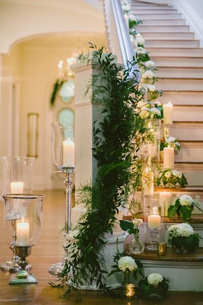 Candles and garland make this staircase absolutely stunning: http://www.stylemepretty.com/little-black-book-blog/2014/10/28/emerald-gold-wedding-inspiration-at-the-merrimon-wynne-house/ | Photography: Rebecca Ames - http://becciames.com/