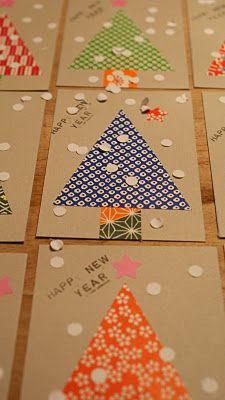 POSTAL O ALBUM: Arbres de Nadal fets amb papers de regal diferents.