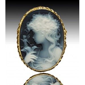 """Flora Cameo, wear it as a brooch or pendant, first quality blue agate, yellow gold setting in Venetian style representing a particoular from Botticelli's """"La Primavera"""". The mysterious lady holding a fairy.   https://www.eredijovon.com/en/2599-lady-with-fairy-blue-cameo-brooch-gold.html    #italiancoraljewels #cammeiitaliani #cameos #cammei #handcarvedcameos #cammeifattiamano #handmadecameos #antiquecameos #vintagecameos #cameolocket #cameonecklace #cameoring #cameobrooch"""