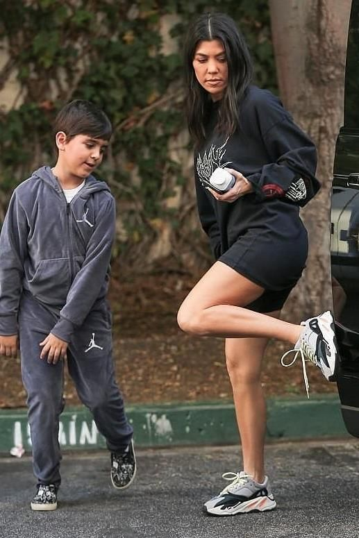Kourtney Kardashian wearing Adidas Yeezy 700 Wave Runner Sneakers 90a6cba8d