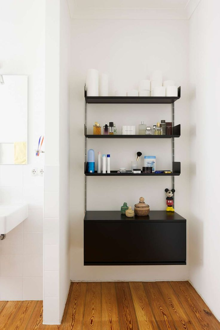 the 606 universal shelving system is also available in black in a