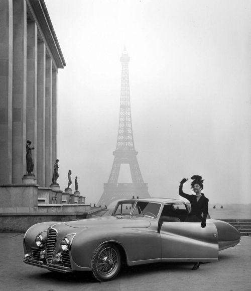 1947 Model is wearing a Fath ensemble posing beside a 1947 model