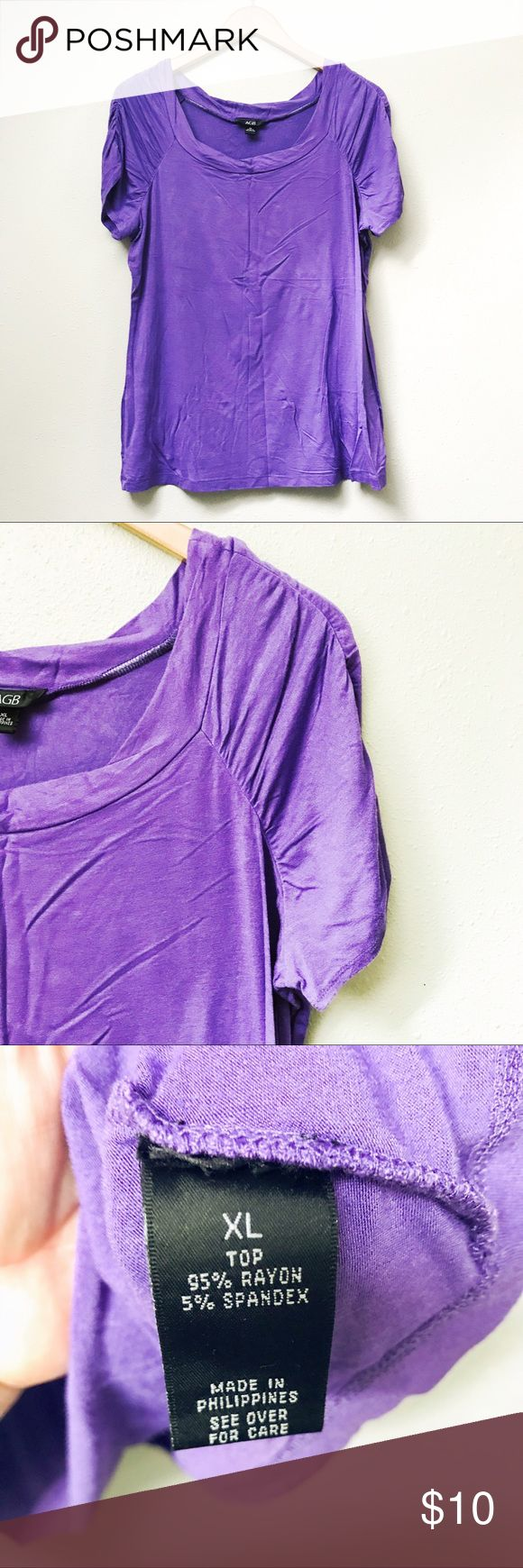 Purple Short Sleeve Top Short-sleeved purple top featuring a scooped neck and ruched shoulder details. New without tags.  ✅Price Firm Unless Bundled ✅Ask About Bundle Special 4 Items $10 & Under 🚫Trades 🚫Off-Posh 🚫Modeling  💞Shop with ease; I'm a Posh Ambassador.💞 AGB Tops Tees - Short Sleeve