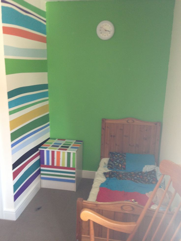 Use frog tape on the wall and lots of tester pots, fab feature wall that cost very little :) (also did same to the bed side table)