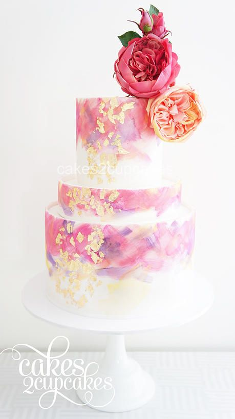 Gold-leafed cake topped with intricate sugar blooms