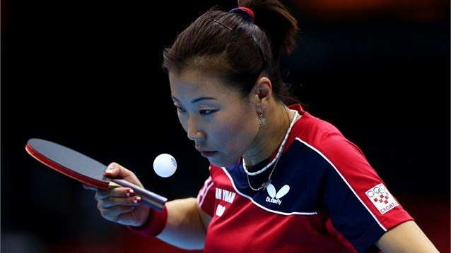 Tian Yuan of Croatia serves against Berta Rodriguez of Chile     Tian Yuan of Croatia serves against Berta Rodriguez of Chile during their Women's Singles Table Tennis match on Day 1 of the London 2012 Olympic Games at ExCeL on 28 July.