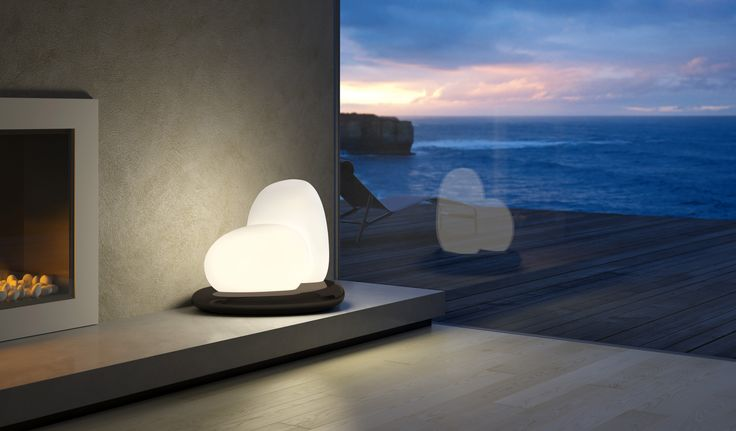 Moai design by Defne Koz for Leucos. The two diffusers in white satin blown glass are inspired by Polynesian sculpture tradition and natural primordial forms. The iconic and sophisticated design combines with the lighting high performance thanks to a double dimmable switch that allows precise light effects' control.