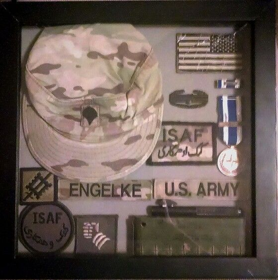 Shadow box of deployment souvenirs