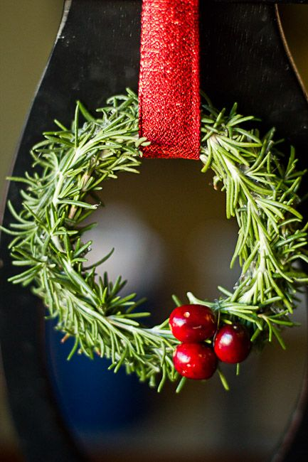 Mini Christmas wreaths. Rosemary glued to a canning jar lid! Easy!