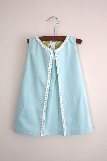 Pleated pom pom baby dress