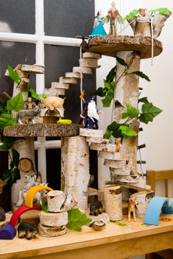Use tree cut offs and hot glue to make a tree house - love it!