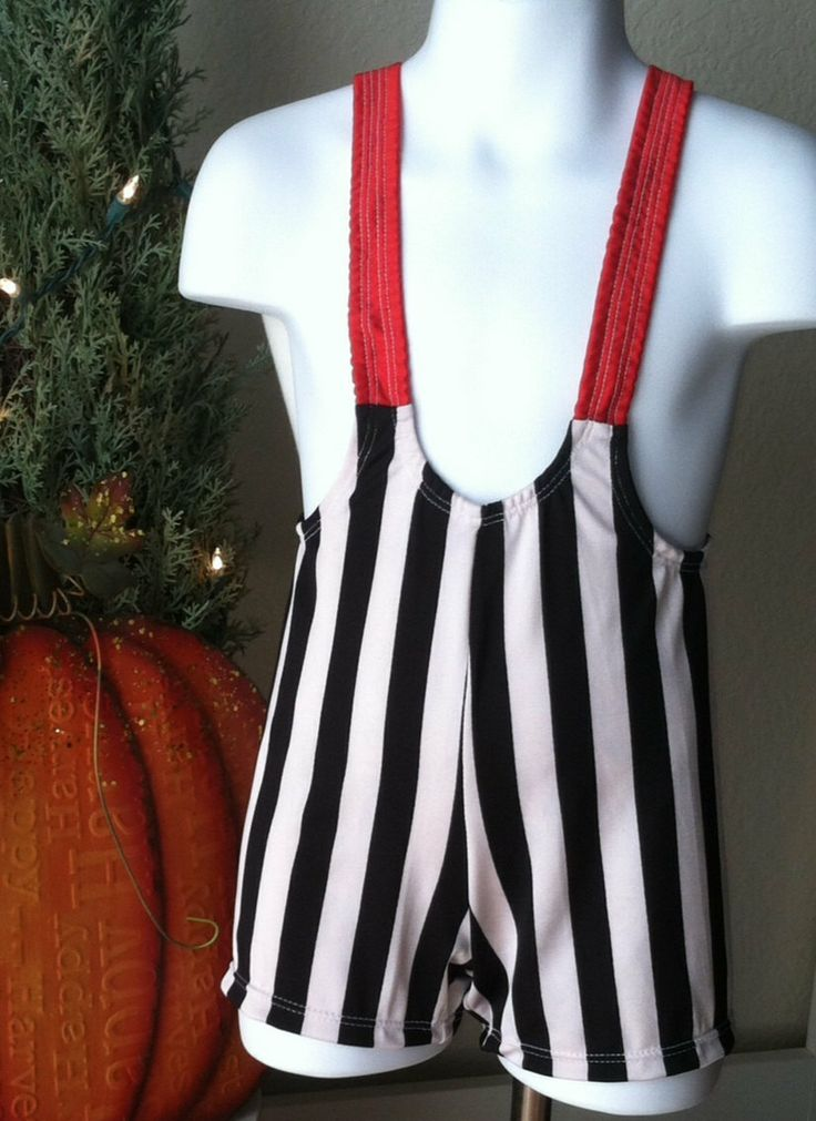 I don't think he'd go for this but dang! Toddler Boy Wrestling Singlet Circus Strong Man Costume by Leotots, $41.99