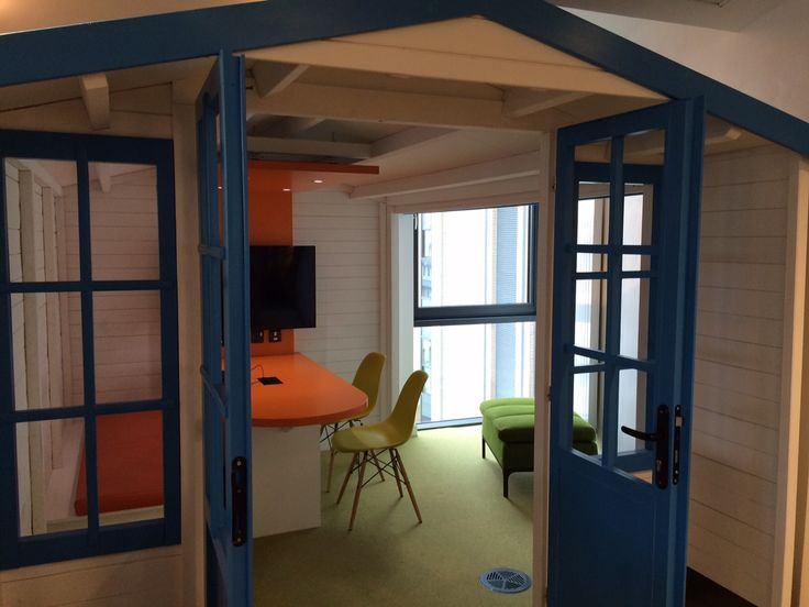Inside the bespoke beach huts at Bournemouth University Student Centre, with Vitra Eames plastic side chairs.