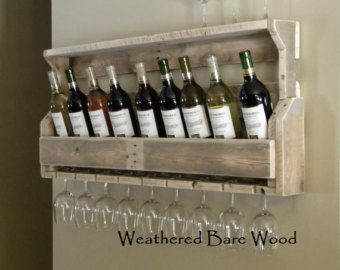 Rustic reclaimed pallet wood wine rack. Rack is handmade one piece at a time. Each piece of wood used is hand selected for its unique character and grain style. All wine racks are slightly sanded to prevent large slivers and snagging rough wood.  STANDARD WINE RACK SIZE: 37 inches long 18 tall  6 inches deep -Dimensions are approximately  Natural Finish - Pictures 4 & 5 finished in a clear sealant letting the woods natural grain and imperfections shine through. Sealant helps protect your ...