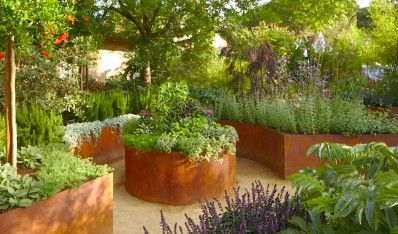 Corten steel raised beds star apple garden design