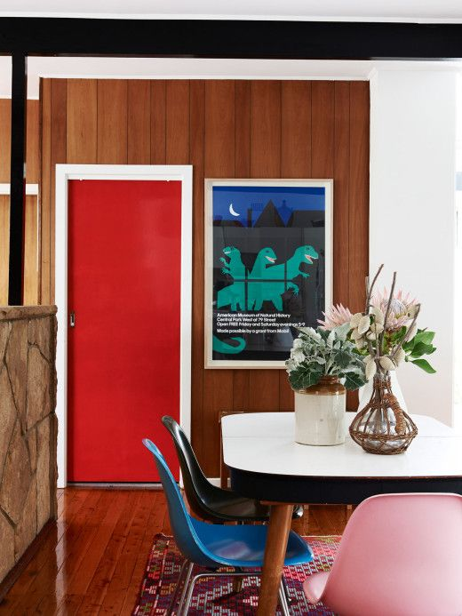 Tim Ross & Michelle Glew-Ross Home - Sydney_The Design Files_Family dining room with 1950's table, colourful Eames chairs and an American Museum of Natural History Poster (New York) c1979
