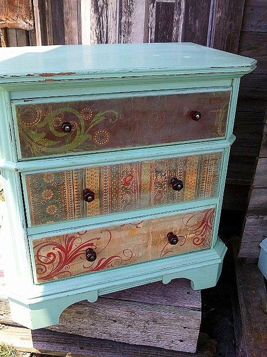 Look can be accomplished with wall paper or decoupage. They sure did sell it for a good price. Spruced up Vintage Dressers by HappyHomeAustin on Etsy, $125.00