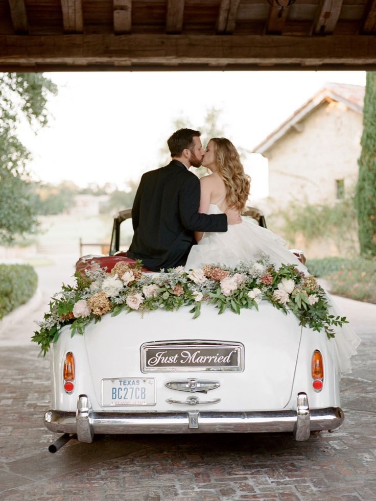 Just married getaway car! Photography: Davy Whitener - www.davywhitener.com   Read More on SMP: http://www.stylemepretty.com/2017/03/06/this-is-how-you-bring-old-world-glamour-to-texas/