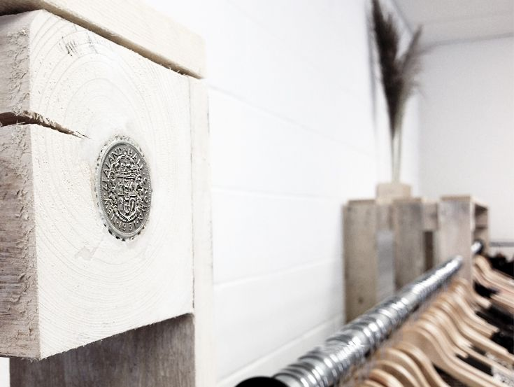Old coins to add interest in recycled timber clothes rack.
