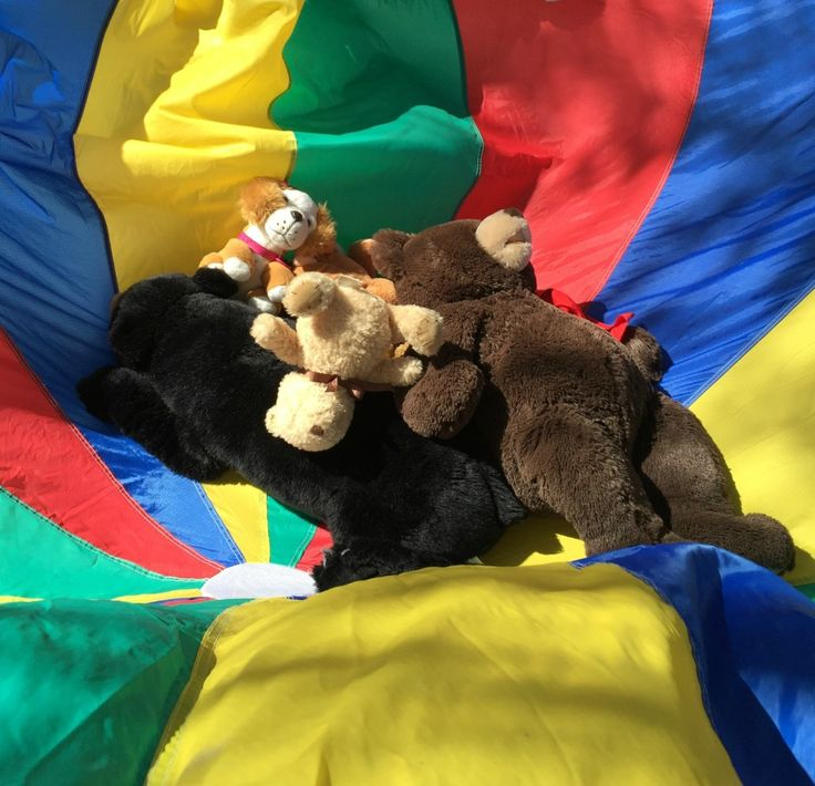 Teddy Bear Day activities for Preschoolers - Teddy Bears getting bounced in the parachute