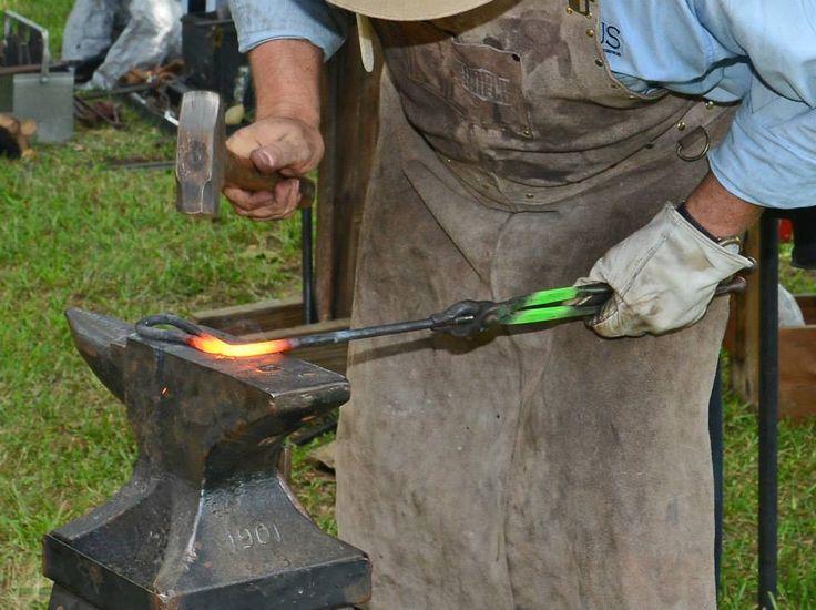 Red River Smiths demonstrating blacksmithing