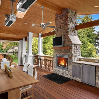 Outdoor fireplace and Beautiful deck!                                                                                                                                                                                 More