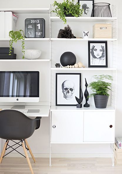 monochrome workspace with white wall mounted shelving