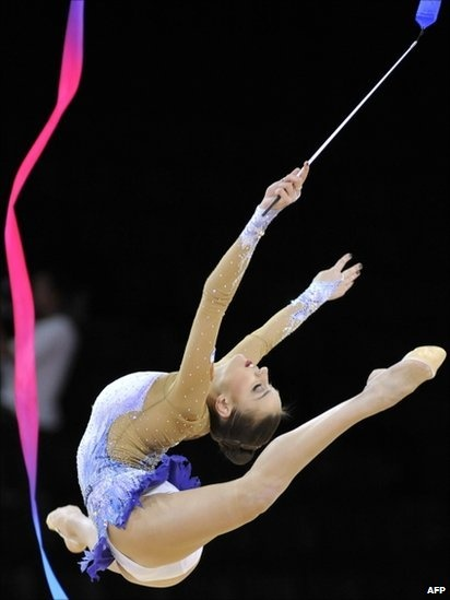 Evgenia Kanaeva of Russia performs with the ribbon to win the gold medal at the 31st Rhythmic Gymnastics World Championships in Montpellier, southern France.