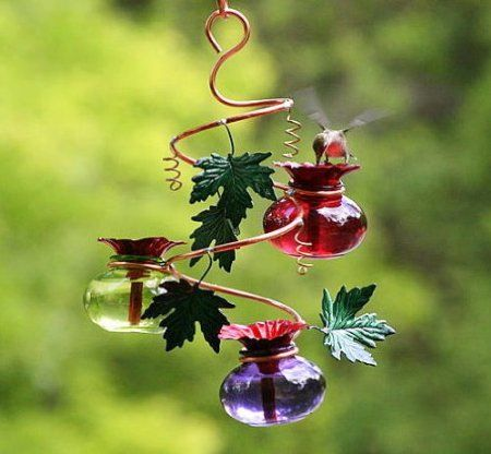 Glass and copper Hummingbird feeder.  See more hummingbird feeders http://thegardeningcook.com/creative-hummingbird-feeders/