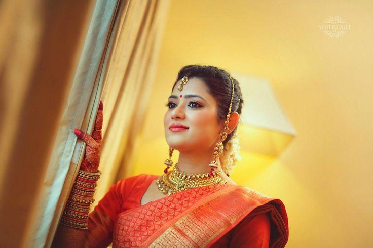 Traditional Southern Indian bride wearing bridal silk saree, jewellery and hairstyle. Temple jewelry. Jhumkis. Silk kanchipuram sari. Braid with fresh flowers. Tamil bride. Telugu bride. Kannada bride. Hindu bride. Malayalee bride. Indian Bridal Makeup. Indian Bridal Fashion.