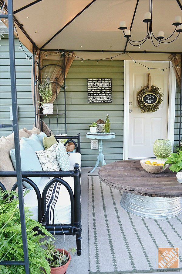 Need a coffee table for your outdoor room? Turn an old galvanized bucket upside down and top it with the top from an old wire spool! | From Liz of Liz Marie blog