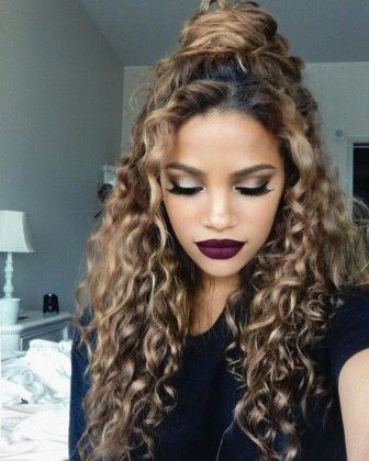 beautiful curls out with a bun at the crown, autumn inspired makeup, dark velvety wine purple lips